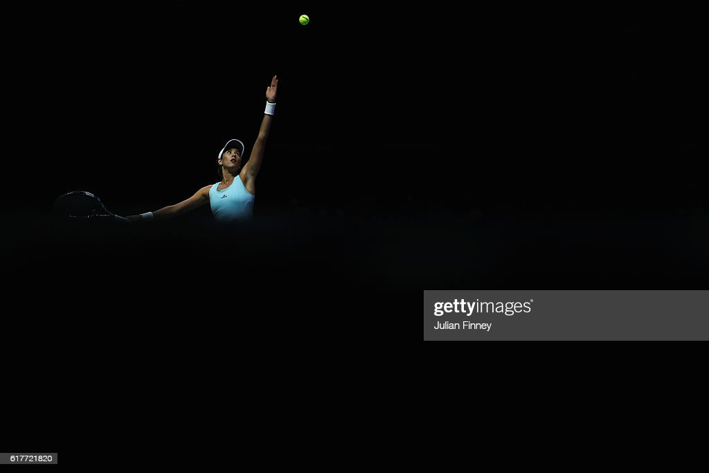 Garbine Muguruza of Spain serves in her singles match against Karolina Pliskova of Czech Republic during the BNP Paribas WTA Finals Singapore at Singapore Sports Hub on October 24, 2016 in Singapore.