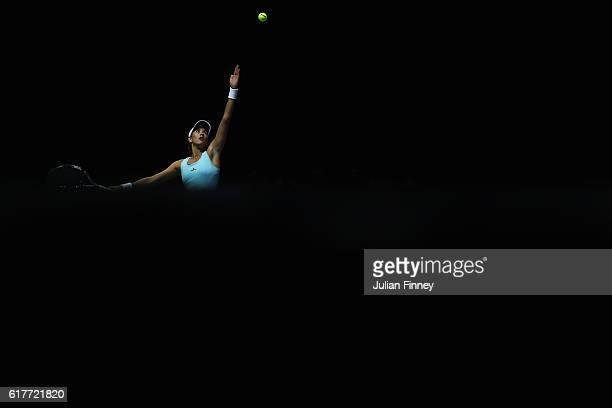 Garbine Muguruza of Spain serves in her singles match against Karolina Pliskova of Czech Republic during the BNP Paribas WTA Finals Singapore at...