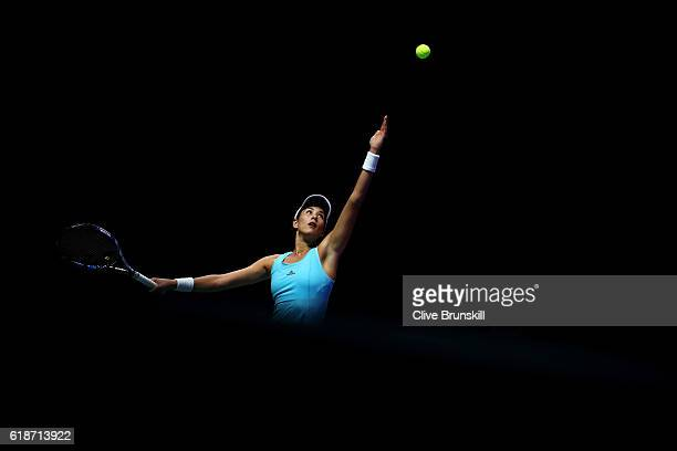 Garbine Muguruza of Spain serves in her singles match against Svetlana Kuznetsova of Russia during day 6 of the BNP Paribas WTA Finals Singapore at...