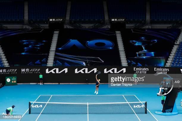 Garbine Muguruza of Spain serves in her Women's Singles fourth round match against Naomi Osaka of Japan during day seven of the 2021 Australian Open...