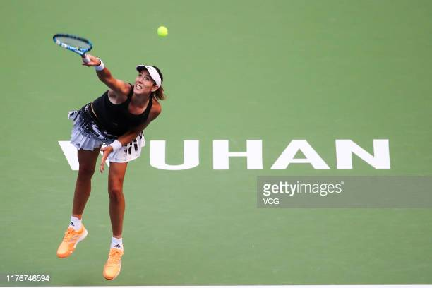 Garbine Muguruza of Spain serves in the second round match against Elina Svitolina of the Ukraine on Day three of 2019 Dongfeng Motor Wuhan Open at...