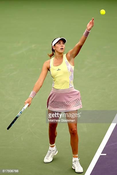 Garbine Muguruza of Spain serves to Dominika Cibulkova of Slovakia during the Miami Open presented by Itau at Crandon Park Tennis Center on March 25...