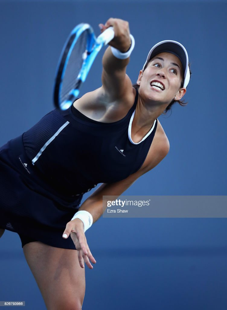 Garbine Muguruza of Spain serves to Madison Keys of the United States during their semifinal match on Day 6 of the Bank of the West Classic at Stanford University Taube Family Tennis Stadium on August 5, 2017 in Stanford, California.