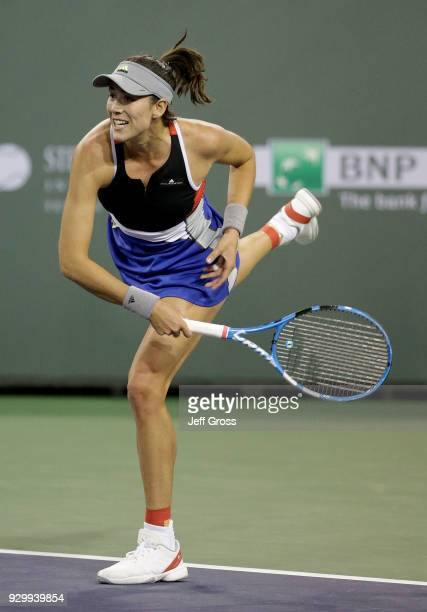 Garbine Muguruza of Spain serves to Sachia Vickery during the BNP Paribas Open at the Indian Wells Tennis Garden on March 9 2018 in Indian Wells...