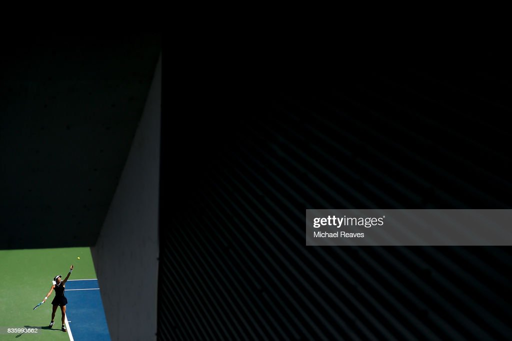 Garbine Muguruza of Spain serves to Simona Halep of Romania during the women's final on Day 9 of the Western and Southern Open at the Linder Family Tennis Center on August 20, 2017 in Mason, Ohio.