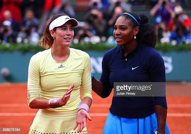 Garbine Muguruza of Spain shakes hands Serena Williams of the United States following her victory during the Ladies Singles final match on day...