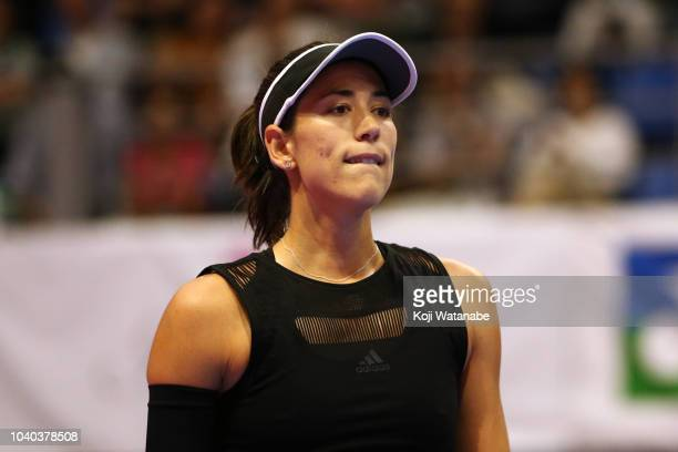 Garbine Muguruza of Spain shows dejection after her defeat by Alison Riske of the United States in the Singles second round on day three of the Toray...