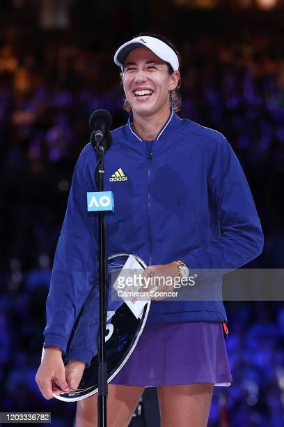 Garbine Muguruza of Spain speaks after receiving the runners up plate after losing her Women's SinglesFinal match against Sofia Kenin of the United...