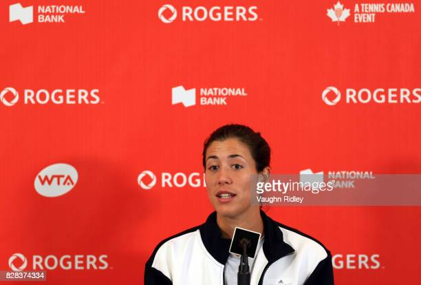 Garbine Muguruza of Spain speaks to the media after defeating Kirsten Flipkens of Belgium during Day 5 of the Rogers Cup at Aviva Centre on August 9...
