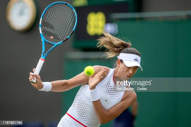July 02: Garbine Muguruza of Spain takes evasive action to a bad kick of the ball off the grass playing surface during her match against Beatriz...