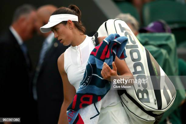 Garbine Muguruza of Spain walks off court after being defeated by Alison Van Uytvanck of Belgium in their Ladies' Singles second round match on day...