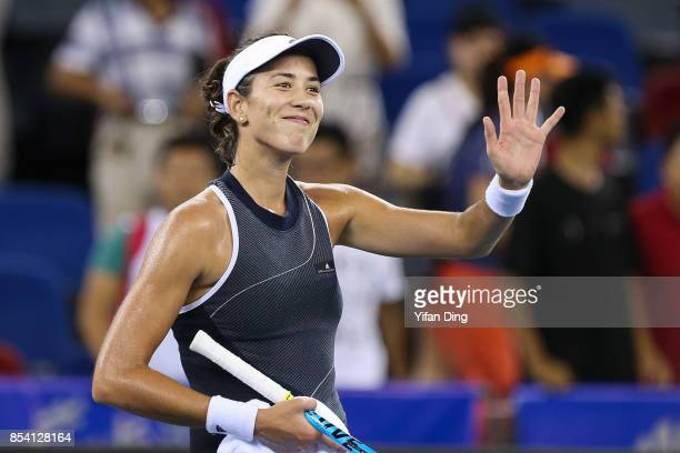 Garbine Muguruza of Spain waves to the camera after winning the second round Ladies Singles match against Lesia Tsurenko of Ukraine on Day 3 of 2017...