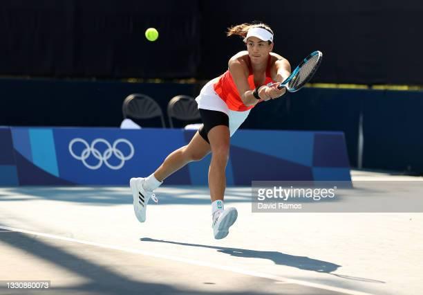 Garbine Muguruza of Team Spain plays a backhand during her Women's Singles Third Round match against Alison Van Uytvanck of Team Belarus on day four...