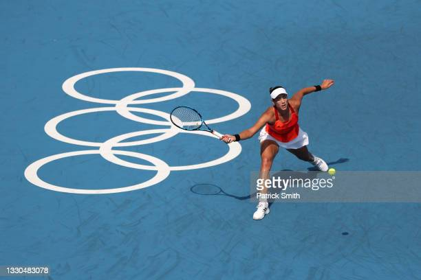 Garbine Muguruza of Team Spain plays a forehand during her Women's Singles First Round match against Veronika Kudermetova of Team ROC on day two of...