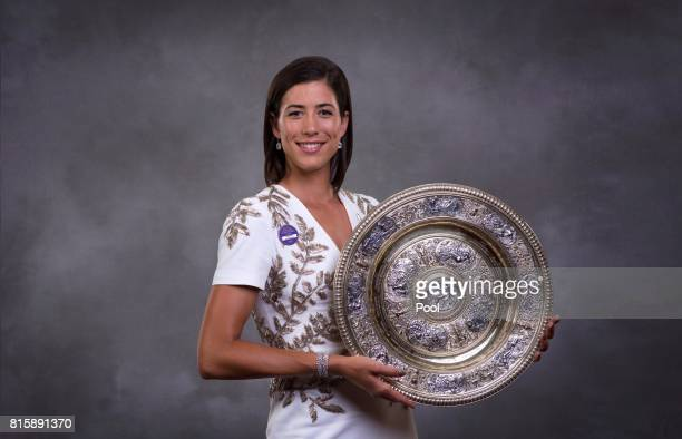 Garbine Muguruza poses with the trophy at the Wimbledon Winners Dinner at The Guildhall on July 16 2017 in London England