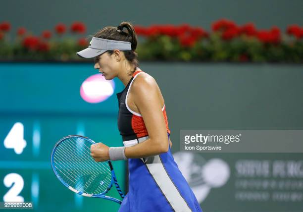 Garbine Muguruza reacts after winning a point during the second round of the BNP Paribas Open on March 09 at the Indian Wells Tennis Gardens in...