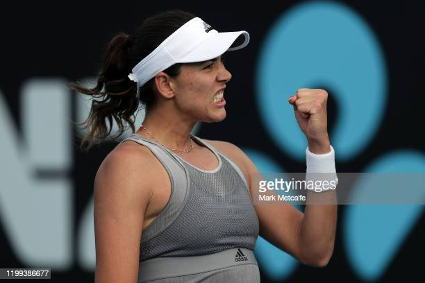 Garbine Murguruza of Spain celebrates winning match point during her first round singles match against Wang Yafan of China during day four of the...
