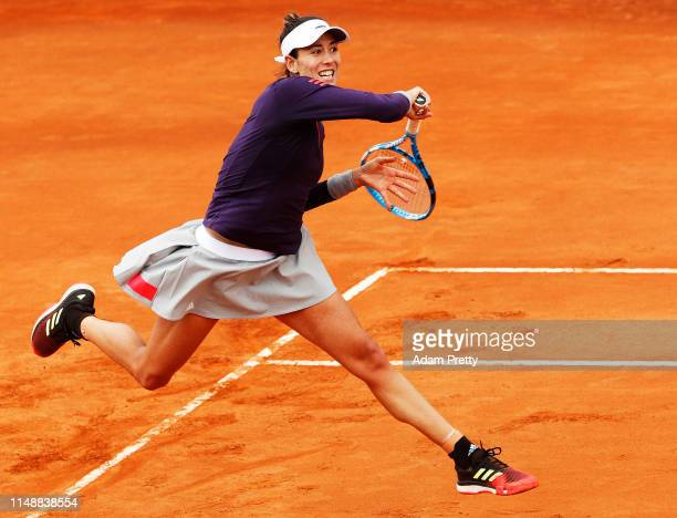Garbine Murguruza of Spain hits a forehand during her first round match against Saisai Zhang of China during day two of the International BNL...