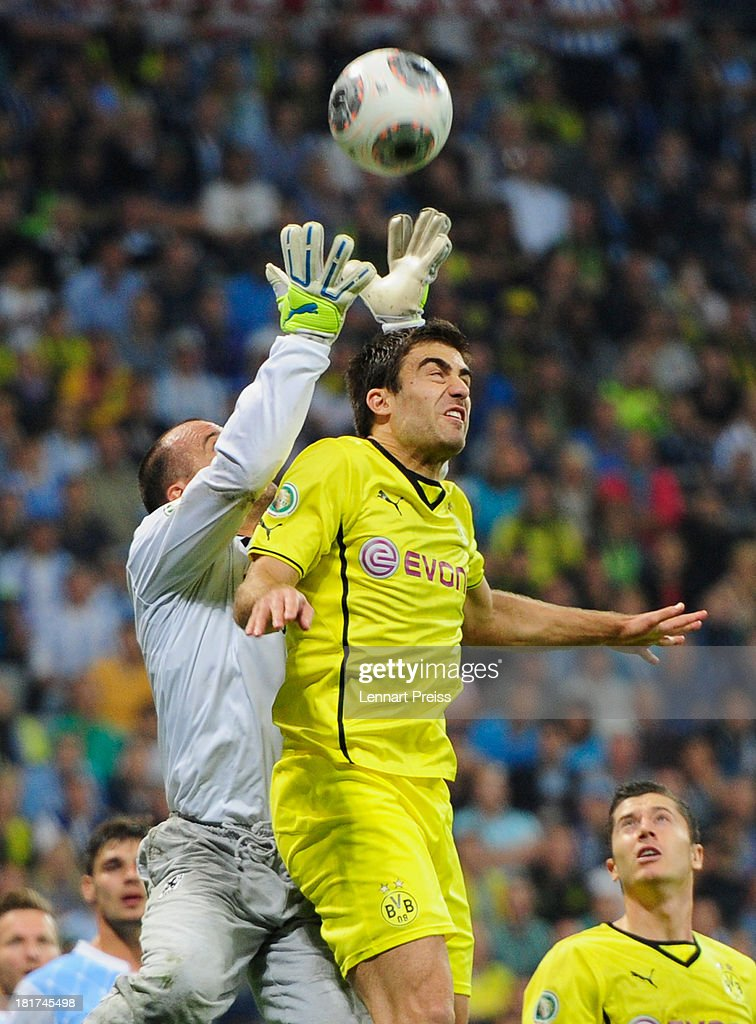 Garbor Kiraly (C) of Muenchen challenges Henrikh Mkhitraryan of Dortmund during the DFB Cup match between TSV 1860 Muenchen and Borussia Dortmund at Allianz Arena on September 24, 2013 in Munich, Germany.