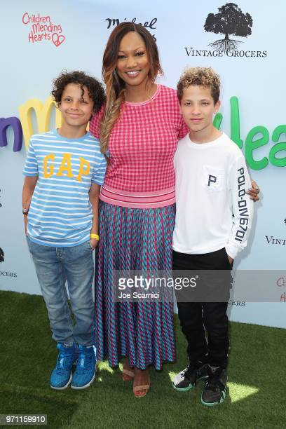 Garcelle Beauvais and family attend the Children Mending Hearts' 10th Annual Empathy Rocks Fundraiser at Private Residence on June 10 2018 in Bel Air...