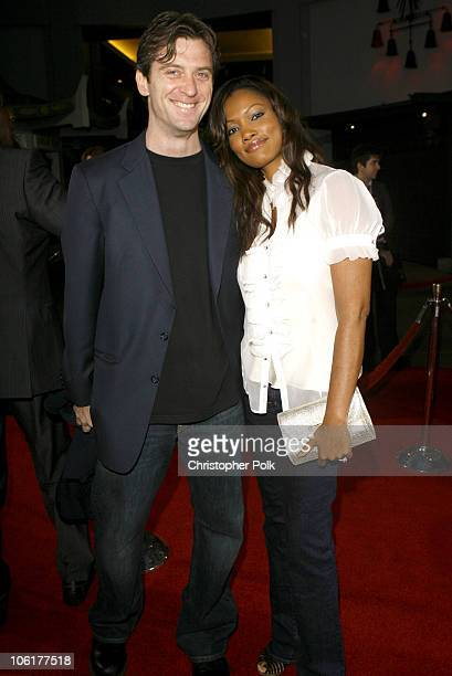 Garcelle Beauvais and her husband Mike Nilon during Disturbia Los Angeles Premiere Red Carpet at Mann's Chinese Theater in Hollywood California...