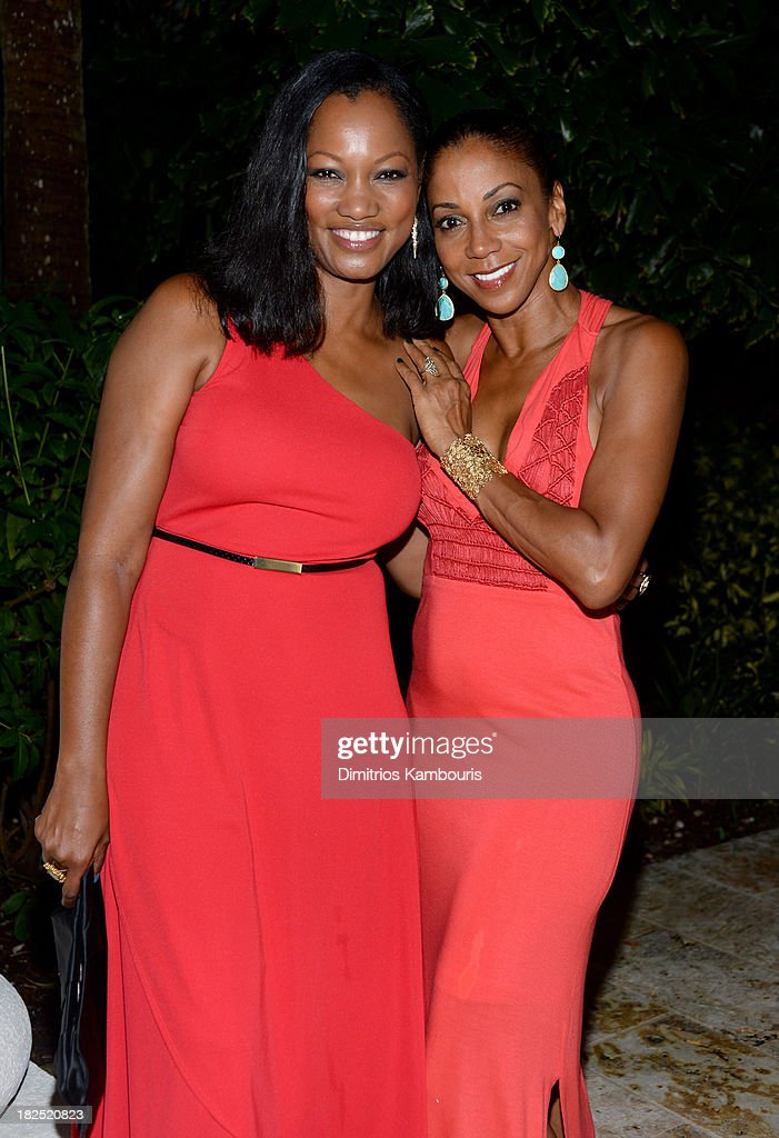 Garcelle Beauvais (L) and Holly Robinson Peete attend the Gala Dinner and Awards during Day Three of the Sandals Emerald Bay Celebrity Getaway and Golf Weekend on September 29, 2013 at Sandals Emerald Bay in Great Exuma, Bahamas.