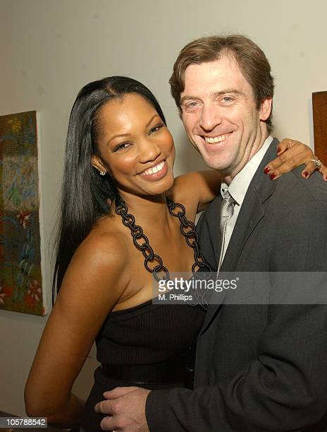 Garcelle Beauvais and husband Mike Nilon during Hunt Slonem Art Exhibit Celebrity Dinner at Don O'Melveny Gallery in Los Angeles California United...