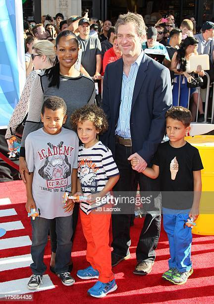 "Garcelle Beauvais and Mike Nilon attend the Disney's ""Planes"" Los Angeles premiere held at the El Capitan Theatre on August 5, 2013 in Hollywood,..."
