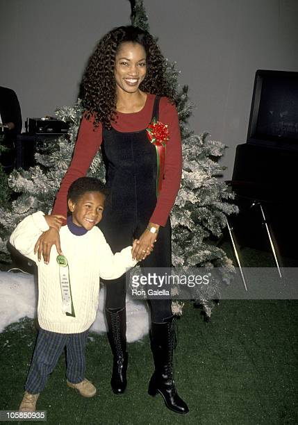 Garcelle Beauvais and Son Oliver Saunders during 63rd Annual Hollywood Christmas Parade at KTLA Studios in Los Angeles CA United States