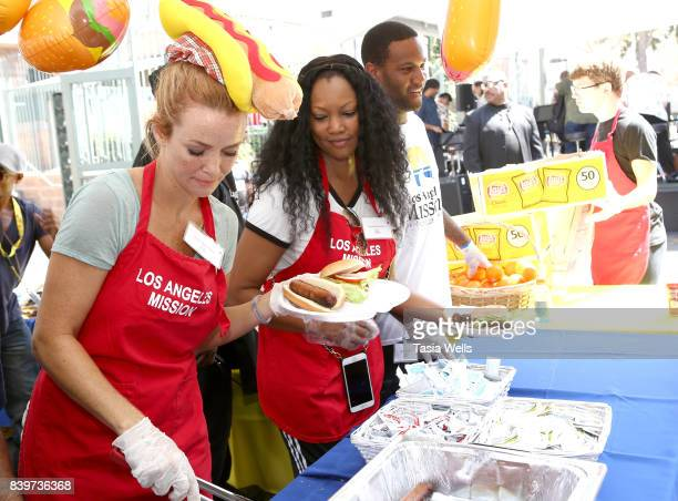 Garcelle Beauvais and son Oliver Saunders volunteer at the Los Angeles Mission's End of Summer Arts and Education Fair at Los Angeles Mission on...