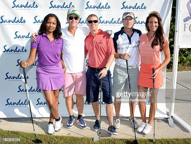 Garcelle Beauvais Billy Bush Sandals Resorts International CEO Adam Stewart Kevin Rahm and Holly Sonders attend the Golf Clinic with Greg Norman and...
