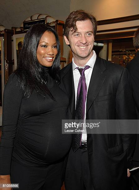 Garcelle Beauvais Nilon and Husband Mike Nilon arrives at the Mann's Village Theater Los Angeles for World premiere of The Kingdom on Sept 17 2007