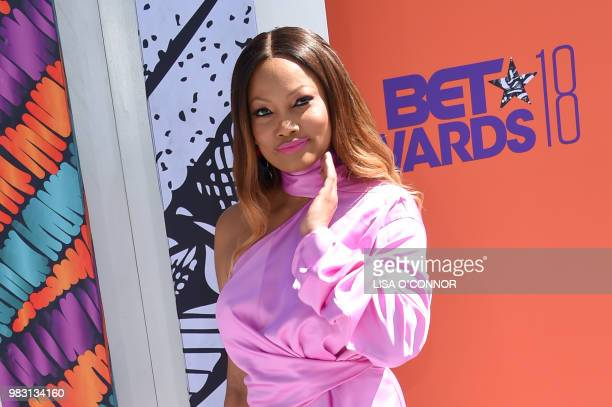 Garcelle Beauvais poses upon arrival for the BET Awards at Microsoft Theatre in Los Angeles California on June 24 2018