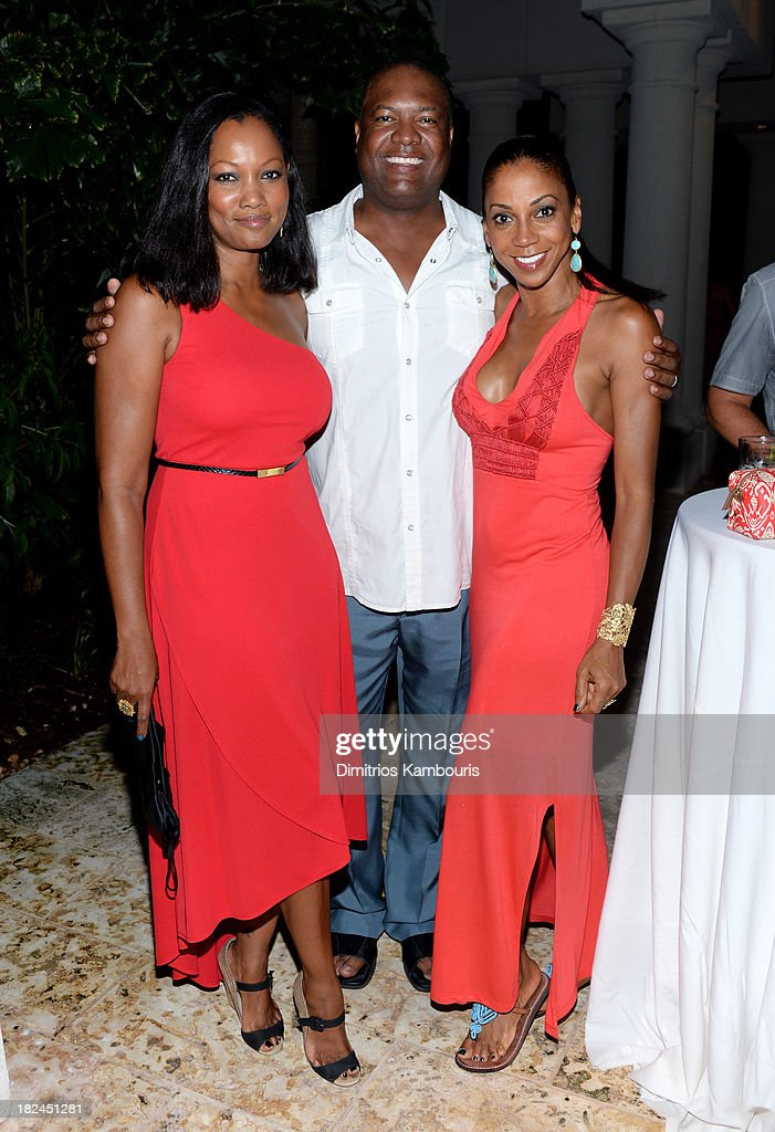 Garcelle Beauvais, Rodney Peete, and Holly Robinson Peete attend the Gala Dinner and Awards during Day Three of the Sandals Emerald Bay Celebrity Getaway and Golf Weekend on September 29, 2013 at Sandals Emerald Bay in Great Exuma, Bahamas.