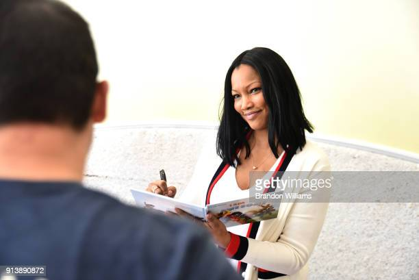Garcelle Beauvais signs her book 'I Am Awesome' during her live book reading at WeVillage Flexible Childcare Center on February 3 2018 in Sherman...