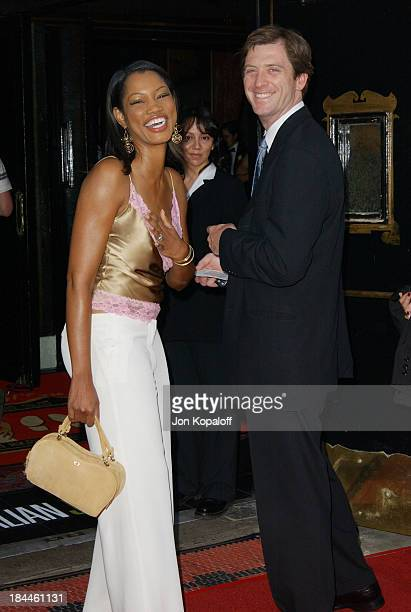 "Garcelle Beauvais-Nilon & husband Mike Nilon during ""The Italian Job"" Premiere Red Carpet Arrivals at Mann's Chinese Theater in Hollywood,..."