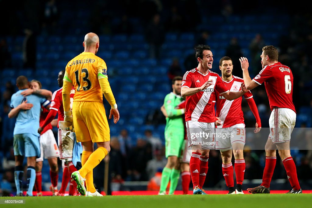 Garcia Kike of Middlesbrough celebrates with team-mate Ben Gibson after the FA Cup Fourth Round match between Manchester City and Middlesbrough at Etihad Stadium on January 24, 2015 in Manchester, England.