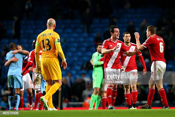 Garcia Kike of Middlesbrough celebrates with teammate Ben Gibson after the FA Cup Fourth Round match between Manchester City and Middlesbrough at...