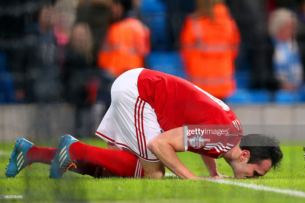 Garcia Kike of Middlesbrough kisses the turf as he celebrates scoring his team's second goal during the FA Cup Fourth Round match between Manchester City and Middlesbrough at Etihad Stadium on January 24, 2015 in Manchester, England.