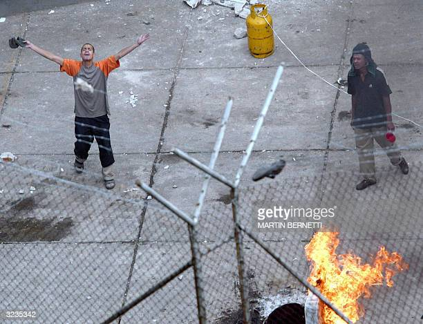 Garcia Moreno prison inmates burn mattresses and shout slogans during a mutiny 06 April 2004 in Quito Ecuador Inmates in Quito prisons are holding...