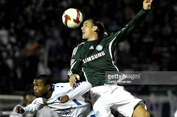 Garcia of Uruguay's Nacional vies for the ball with Marcao Brazil's Palmeiras during their quarter final round match of the Santander Libertadores...