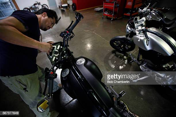 Gard Hollinger puts a cowling on a KRGT1 motorcycle next to the work bay oat Arch Motorcycles in Hawthorne on NOVEMBER 05 2014