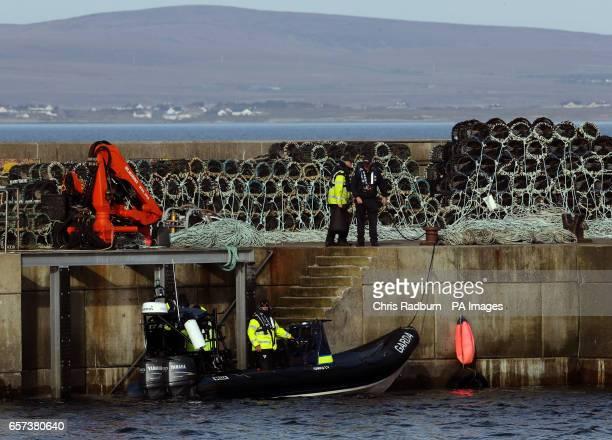 Garda and members of the Irish Coastguard alongside the Quay at Blacksod Co Mayo Ireland as dive teams have begun searching the wreckage of an Irish...