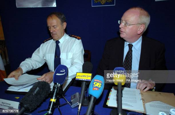 Garda Commissioner Noel Conroy and Minister for Justice Michael McDowell at a press conference They called on finance houses and security firms to...
