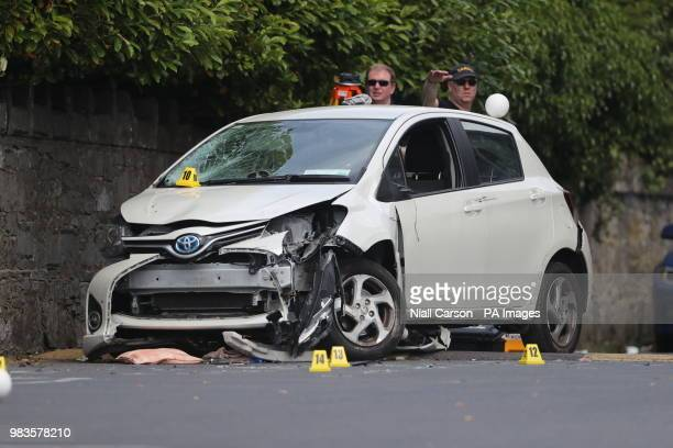 f9b2952e42 Garda forensic officers with a damaged car in the grounds of the Church of  the Immaculate