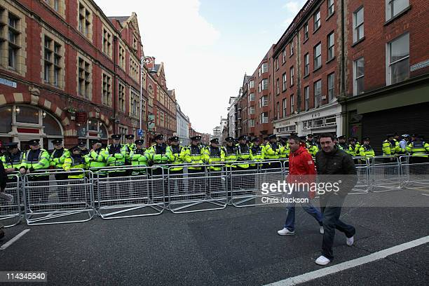 Garda form a protective ring during protests as the Queen attends a state dinner in Dublin Castle on May 18 2011 in Dublin Ireland The Duke and...