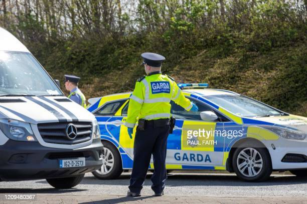 Garda Irish Police conduct a traffic checkpoint on the outskirts of Dublin Ireland on April 8 2020 as police excercised new powers to restrict...