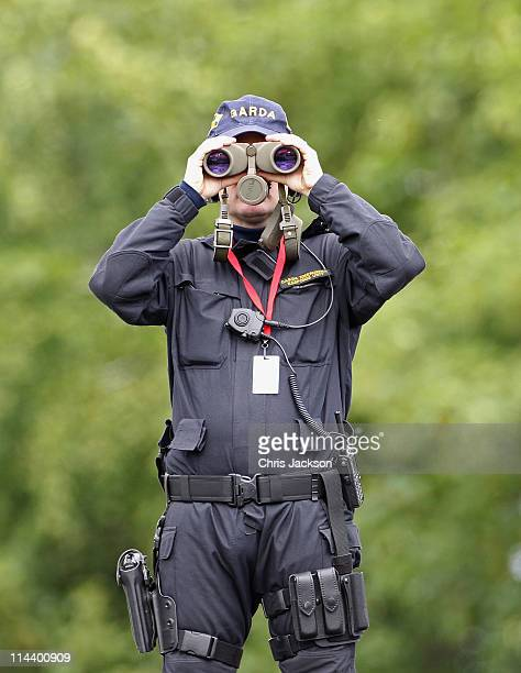 Garda keeps watch as Queen Elizabeth II visits the Irish National Stud on May 19 2011 in Kildare Ireland The Duke and Queen's visit to Ireland is the...