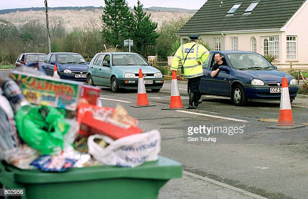 Garda man a foot and mouth disease checkpoint April 17 2001 in County Louth on the border between Northern Ireland and the Republic of Ireland All...