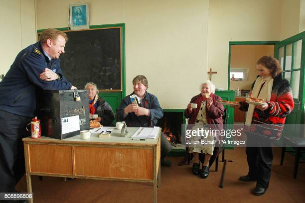 Garda Martin Reilly from Achill chats with islanders and voters Annie Calvey Presiding Officer Michael Leneghan Bridgie O'Malley and Kate Calvey over...